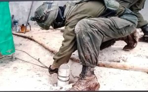 Soldier wiring a discovered Hezbollah tunnel for destruction.